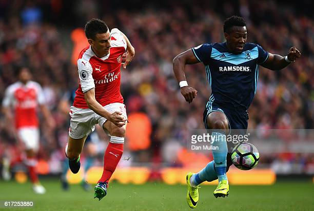 Adama Traore of Middlesbrough takes the ball past Laurent Koscielny of Arsenal during the Premier League match between Arsenal and Middlesbrough at...