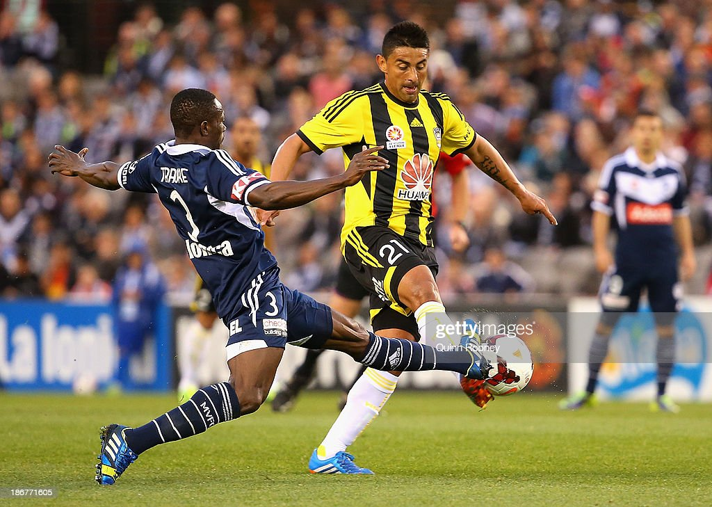 Adama Traore of the Victory and Carlos Hernandez of the Phoenix contest for the ball during the round four A-League match between Melbourne Victory and Wellington Phoneix at Etihad Stadium on November 4, 2013 in Melbourne, Australia.