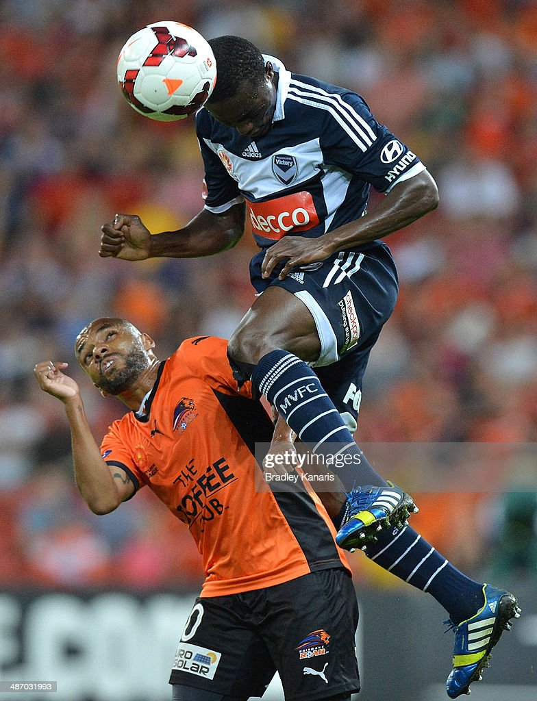 Adama Traore of the Victory gets above Henrique of the Roar during the A-League Semi Final match between the Brisbane Roar and Melbourne Victory at Suncorp Stadium on April 27, 2014 in Brisbane, Australia.