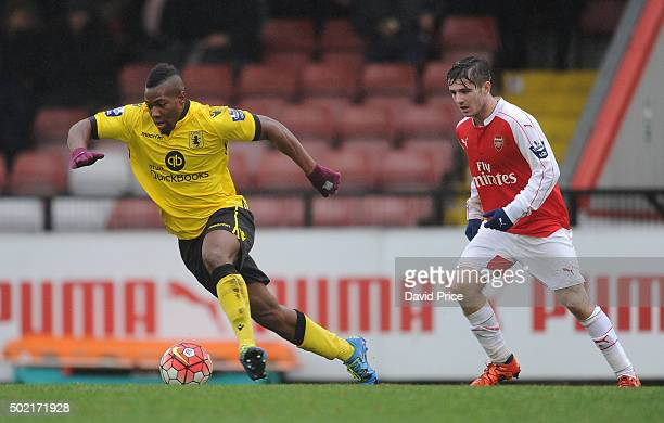Adama Traore of Villa races away from Dan Crowley of Arsenal during the match between Arsenal U21 and Aston Villa U21 at Meadow Park on December 21...
