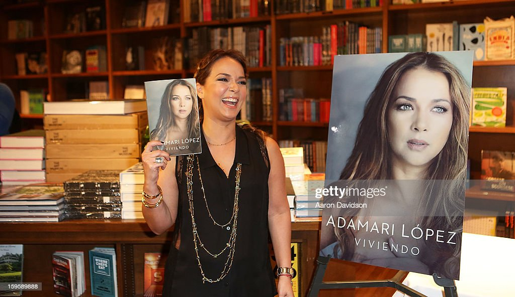 <a gi-track='captionPersonalityLinkClicked' href=/galleries/search?phrase=Adamari+Lopez&family=editorial&specificpeople=2550892 ng-click='$event.stopPropagation()'>Adamari Lopez</a> greets fans and signs copies of her book 'Viviendo' at Books and Books on January 16, 2013 in Coral Gables, Florida.