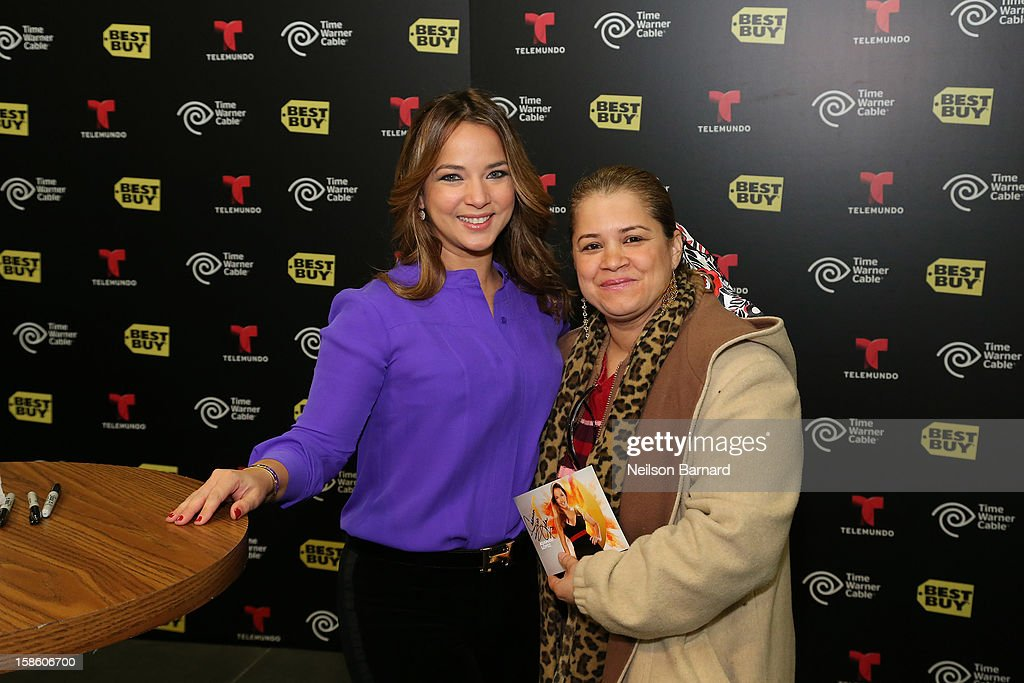 <a gi-track='captionPersonalityLinkClicked' href=/galleries/search?phrase=Adamari+Lopez&family=editorial&specificpeople=2550892 ng-click='$event.stopPropagation()'>Adamari Lopez</a> greets fans at the Time Warner Cable meet and greet at Best Buy Union Square on December 20, 2012 in New York City.