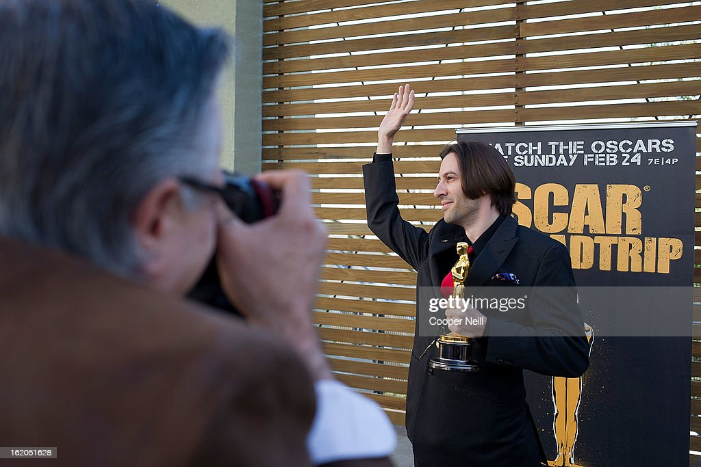 M. Adamic poses with an Oscar trophey during First-Ever Oscar Roadtrip at the Angelika Film Center on February 18, 2013 in Dallas.