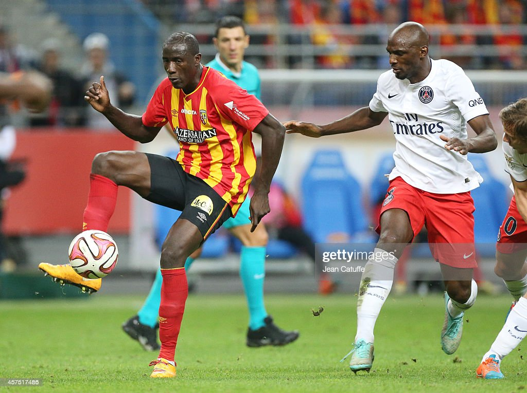 Adamo Coulibaly of Lens and <a gi-track='captionPersonalityLinkClicked' href=/galleries/search?phrase=Zoumana+Camara&family=editorial&specificpeople=729000 ng-click='$event.stopPropagation()'>Zoumana Camara</a> of PSG in action during the French Ligue 1 match between RC Lens and Paris Saint-Germain FC at Stade de France on October 17, 2014 in Saint-Denis near Paris, France.