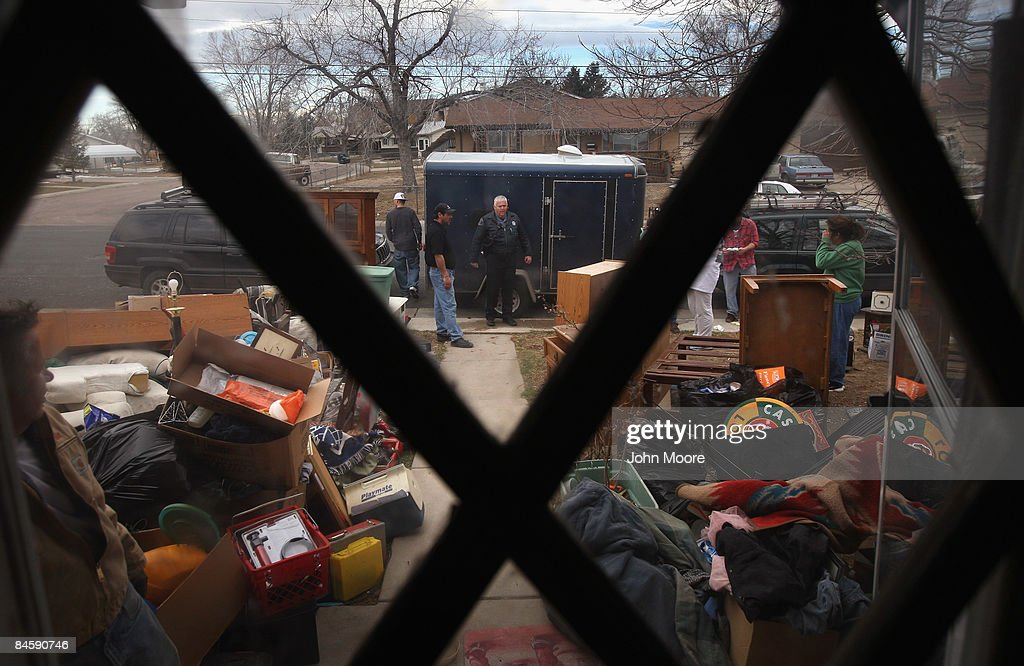 Adams Country sheriff's deputy Greg Barnett (C), looks on after an eviction team carried out a family's belongings during a foreclosure eviction February 2, 2009 in Adams County, Colorado. The family had been renting from an owner, who collected the monthly payments but had stopped paying his mortgage, according to renter Tracy Munch. The bank foreclosed on the property and called the Adams County sheriff's department to supervise the eviction. They managed to borrow enough money to rent another house for themselves and their four children, she said, but not in time to avoid eviction.