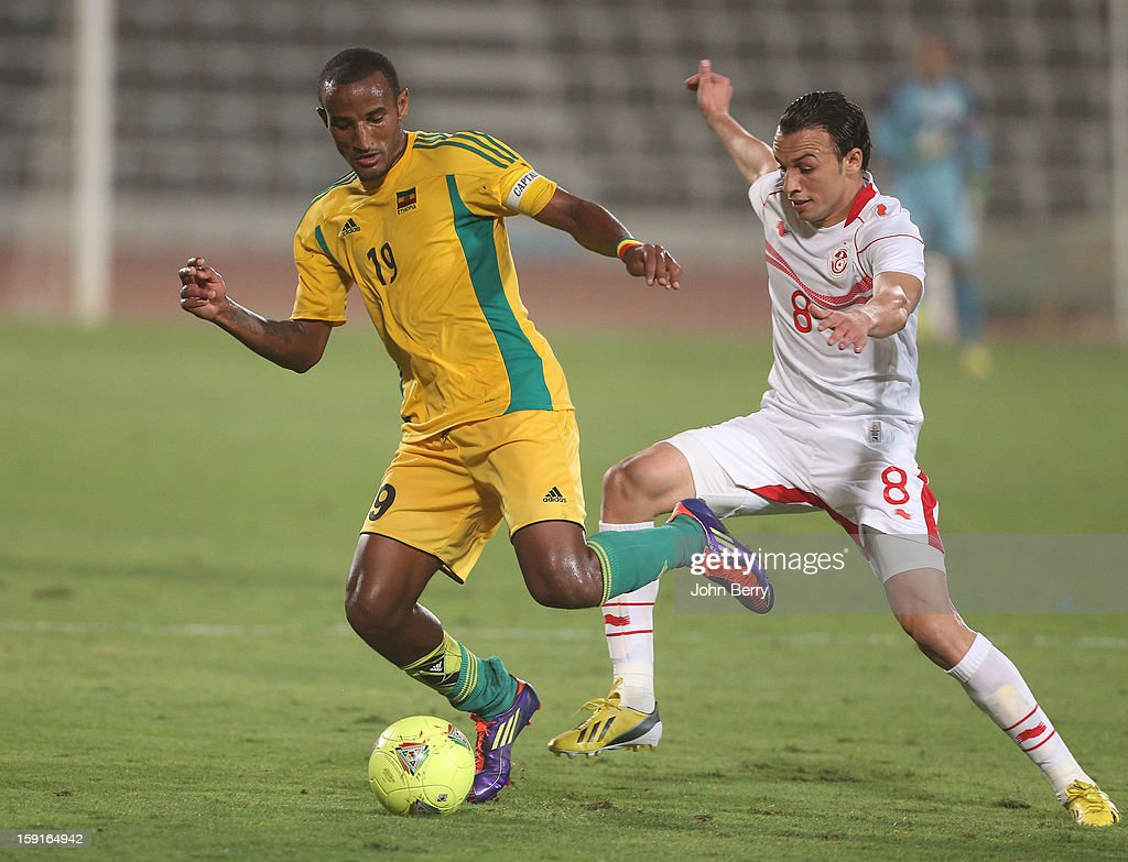 Adane Girma (L) of Ethiopia and Chadi Hammami of Tunisia in action during the international friendly game between Tunisia and Ethiopia at the Al Wakrah Stadium on January 7, 2013 in Doha, Qatar.
