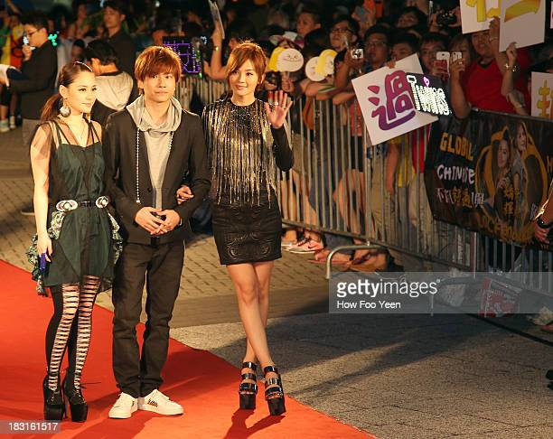 Adason Loi Gillian and Charlene Choi of Hong Kong arrives on the red capet prior to the start of the 13th Global Chinese Music Awards at Putra...