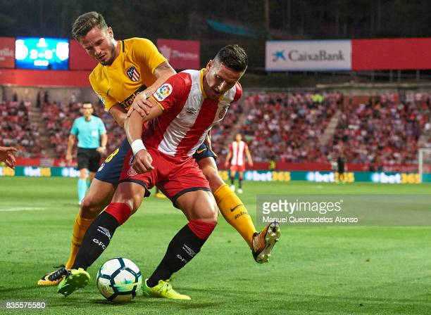 Aday Benitez of Girona competes for the ball with Saul Niguez of Atletico de Madrid during the La Liga match between Girona and Atletico Madrid at...