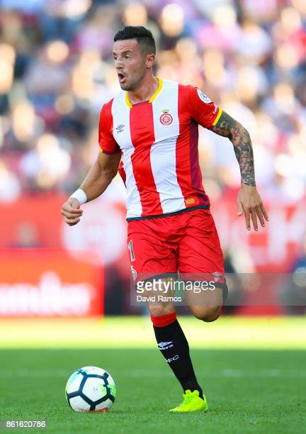 Aday Benitez of Girona FC runs with the ball during the La Liga match between Girona and Villarreal at Estadi de Montilivi on October 15 2017 in...