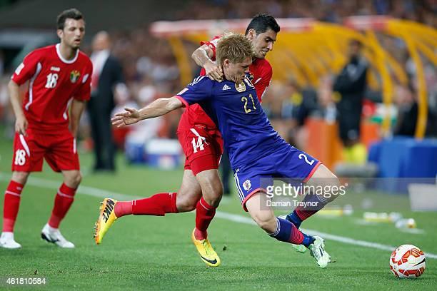 Adballah Deeb of Jordan takes down Gotoku Sakai of Japan during the 2015 Asian Cup match between Japan and Jordan at AAMI Park on January 20 2015 in...
