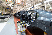 Automated car Assembly line. The plant of the automotive industry. Line of car body