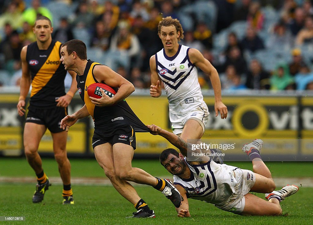 Addam Maric of the Tigers is challenegd by his opponent during the round 11 AFL match between the Richmond Tigers and the Fremantle Dockers at Melbourne Cricket Ground on June 9, 2012 in Melbourne, Australia.