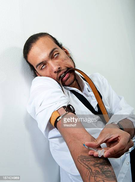 Drug addiction tattoos stock photos and pictures getty for Drug addiction tattoos