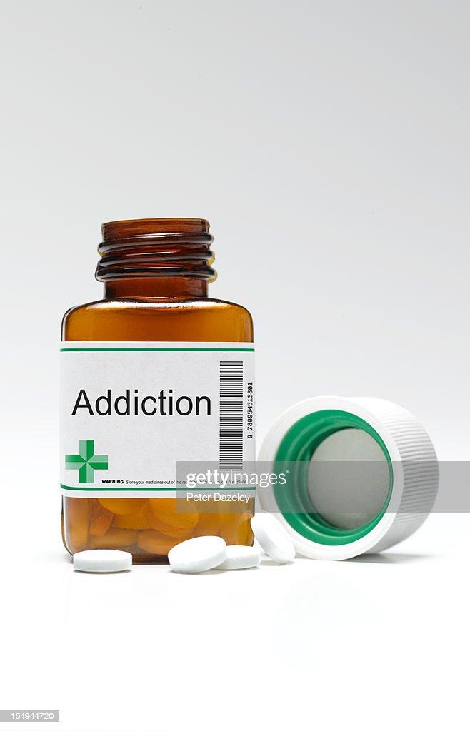 Addiction pill bottle and pills : Stock Photo