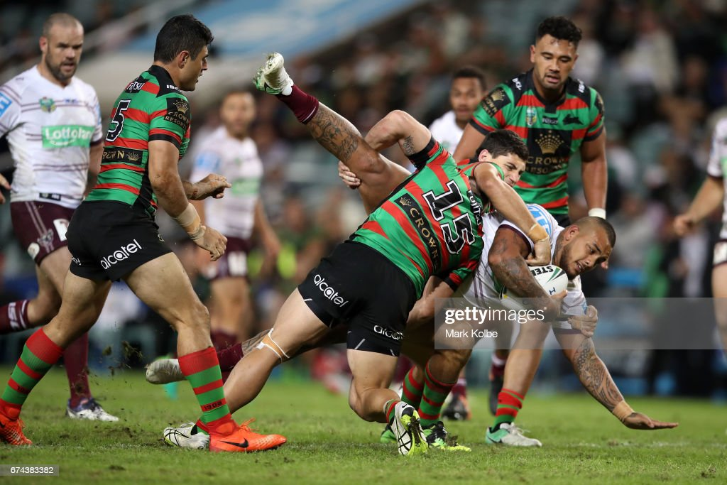 Addin Fonua-Blake of the Sea Eagles is tackled by Jason Clark and Kyle Turner of the Rabbitohs during the round nine NRL match between the South Sydney Rabbitohs and the Manly Sea Eagles at Allianz Stadium on April 28, 2017 in Sydney, Australia.