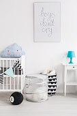 Shot of a black and white baby room with blue accessories
