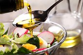 Vegetable salad with eggs and pouring oil.
