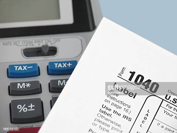 Adding Machine and 1040 Tax Form