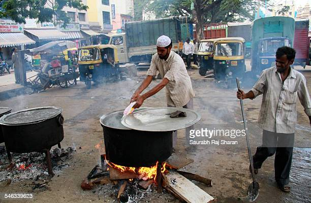 Adding salt to the Biriyani The chef is cooking large amount of Biriyani for ramzan in Bangalore