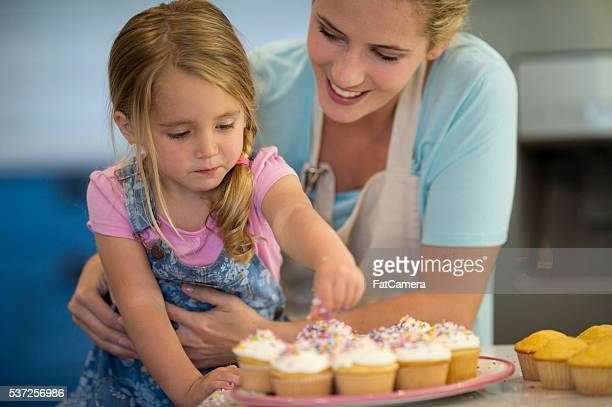 Adding Sprinkles on Top of the Cupcakes