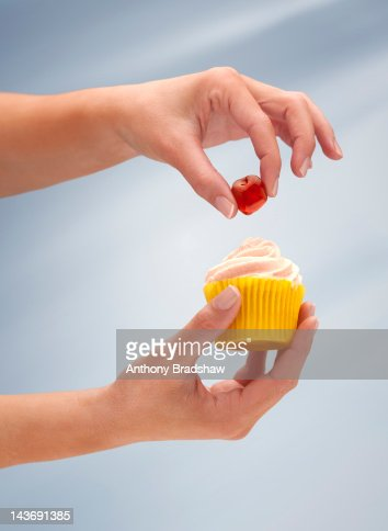 Adding The Cherry On The Cake Stock Photo