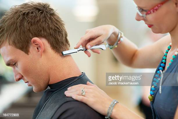 Adding the finishing touches to his hairstyle
