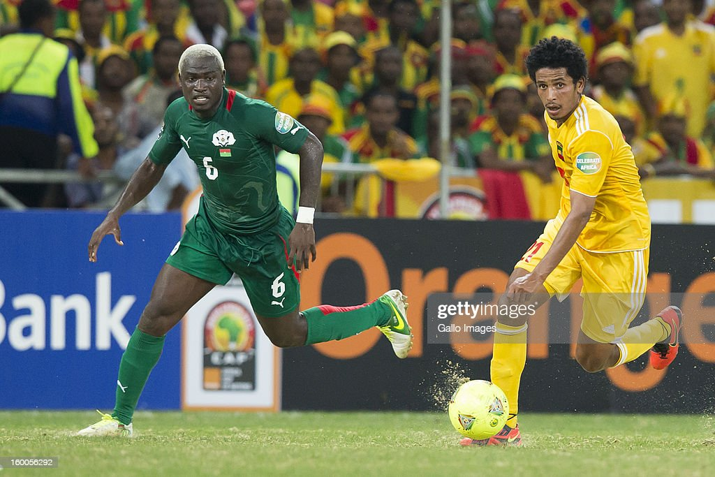 Addis Hintsa Tekle of Ethiopia and Djakaridja Kone of Burkina Faso compete during the 2013 African Cup of Nations match between Burkina Faso and Ethiopia from Mbombela Stadium on January 25, 2013 in Nelspruit, South Africa.