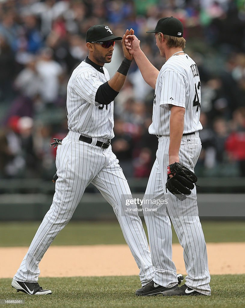 Addison Reed #43 (R) and Alex Rios #51 of the Chicago White Sox celebrate a win against the Seattle Mariners at U.S. Cellular Field on April 6, 2013 in Chicago, Illinois. The White Sox defeated the Mariners 4-3.