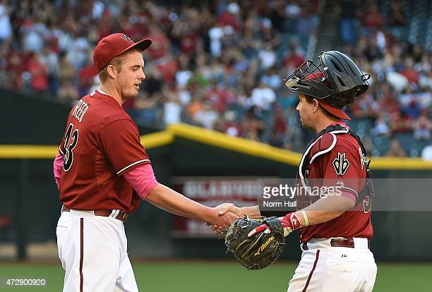 Addison Reed and Tuffy Gosewisch of the Arizona Diamondbacks celebrate a 21 win against the San Diego Padres at Chase Field on May 10 2015 in Phoenix...