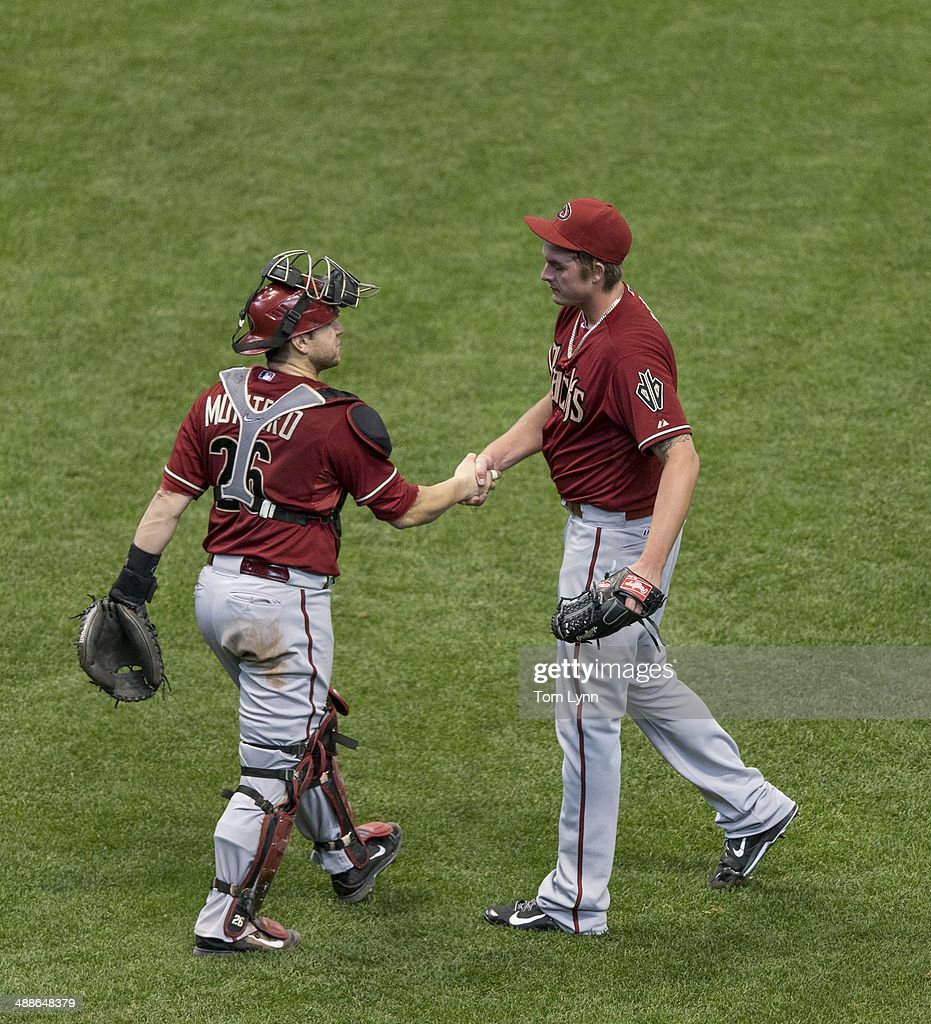 Addison Reed #43 of the Arizona Diamondbacks and catcher Miguel Montero #26 shake hands after defeating the Milwaukee Brewers at Miller Park on May 7, 2014 in Milwaukee, Wisconsin.