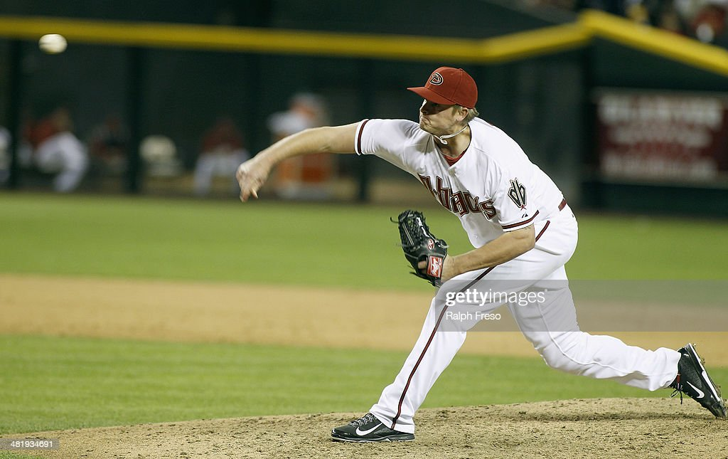 <a gi-track='captionPersonalityLinkClicked' href=/galleries/search?phrase=Addison+Reed&family=editorial&specificpeople=8195266 ng-click='$event.stopPropagation()'>Addison Reed</a> #43 of the Arizona Diamondbacks delivers a pitch against the San Francisco Giants during the ninth inning of a MLB game at Chase Field on April 1, 2014 in Phoenix, Arizona. The Diamondbacks defeated the Giants 5-4.