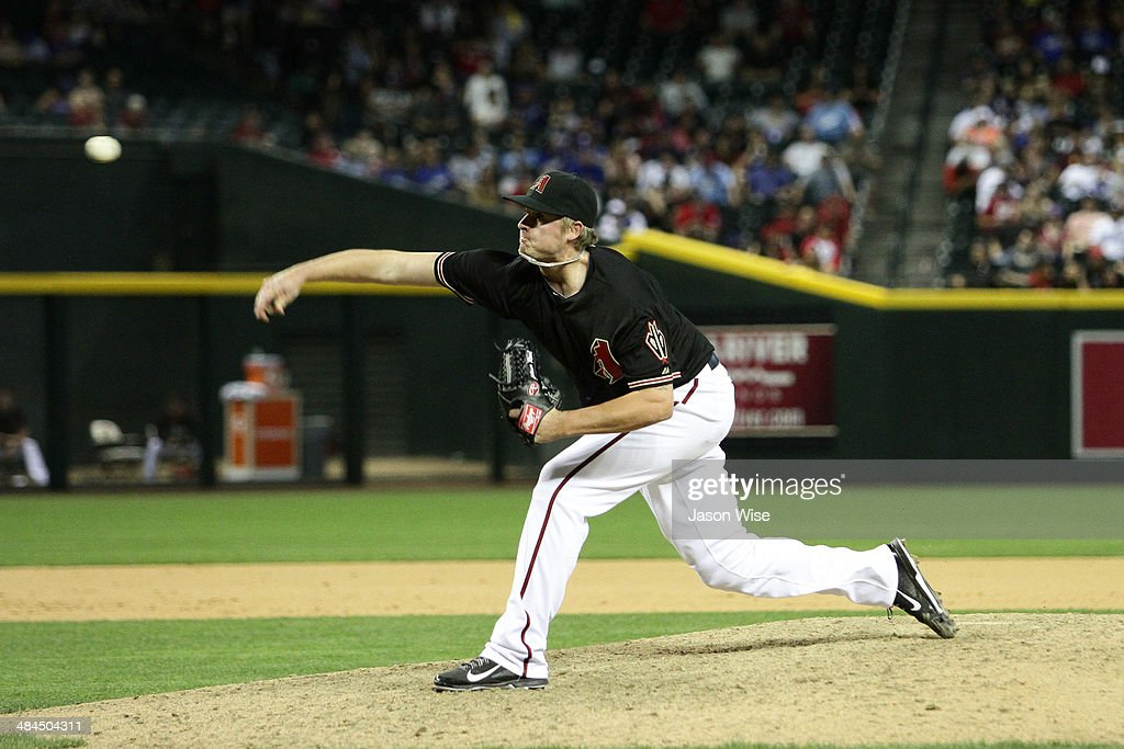 <a gi-track='captionPersonalityLinkClicked' href=/galleries/search?phrase=Addison+Reed&family=editorial&specificpeople=8195266 ng-click='$event.stopPropagation()'>Addison Reed</a> #43 of the Arizona Diamondbacks delivers a pitch against the Los Angeles Dodgers in the ninth at Chase Field on April 12, 2014 in Phoenix, Arizona.