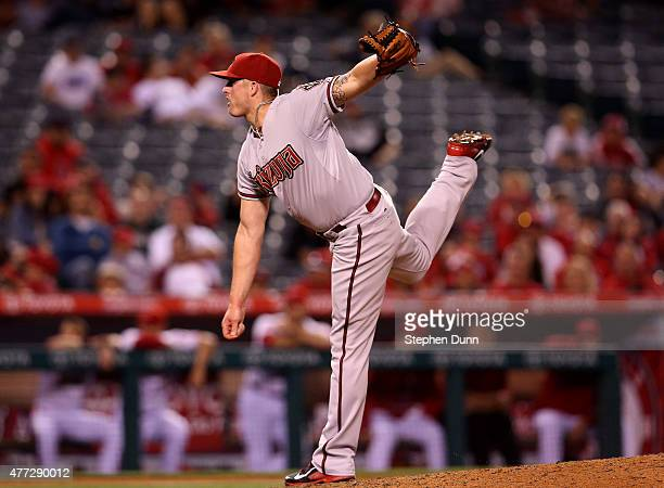 Addison Reed of the Arizona Diamondbacks follows through on a pitch in the ninth inning on his way to picking up the save against the Los Angeles...