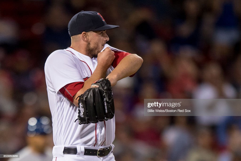 Addison Reed #43 of the Boston Red Sox reacts after allowing a solo home run during the ninth inning of a game against the Toronto Blue Jays on September 25, 2017 at Fenway Park in Boston, Massachusetts.