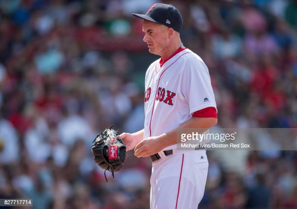 Addison Reed of the Boston Red Sox walks off the mound after pitching a clean seventh inning against the Chicago White Sox on August 6 2017 in Boston...