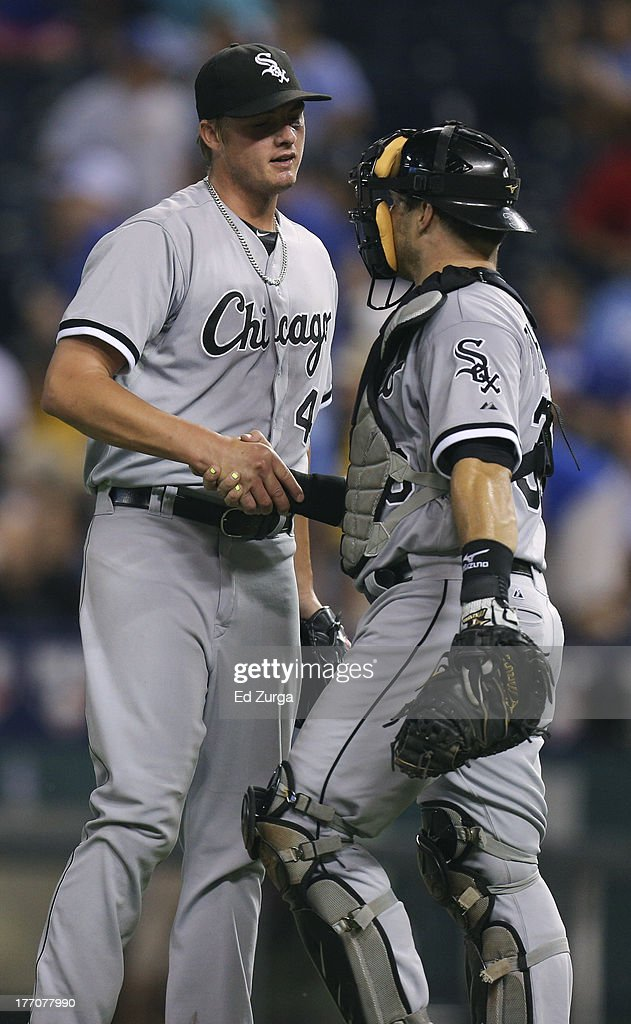 Addison Reed #43 of the Chicago White Sox and Josh Phegley #36 celebrate a 2-0 win over the Kansas City Royals at Kauffman Stadium August 20, 2013 in Kansas City, Missouri.