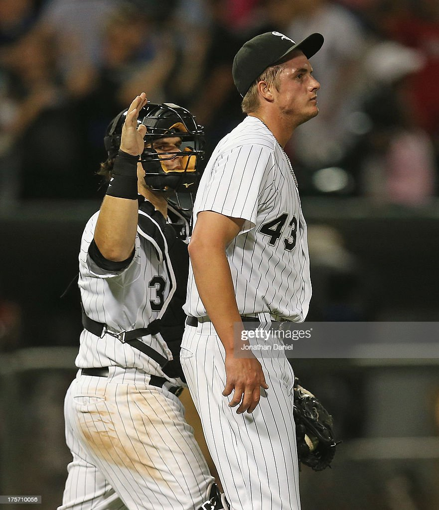 Addison Reed #43 of the Chicago White Sox gets a pat on the back from Josh Phegley #36 after getting his 27th save of the season against the New York Yankees at U.S. Cellular Field on August 6, 2013 in Chicago, Illinois. The White Sox defeated the Yankees 3-2.