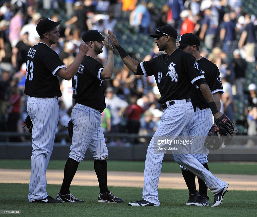 Addison Reed #43 of the Chicago White Sox, <a gi-track='captionPersonalityLinkClicked' href=/galleries/search?phrase=Jeff+Keppinger&family=editorial&specificpeople=835796 ng-click='$event.stopPropagation()'>Jeff Keppinger</a> #7 and <a gi-track='captionPersonalityLinkClicked' href=/galleries/search?phrase=Alex+Rios&family=editorial&specificpeople=224676 ng-click='$event.stopPropagation()'>Alex Rios</a> #51 celebrate their win against the Atlanta Braves on July 20, 2013 at U.S. Cellular Field in Chicago, Illinois. The Chicago White Sox defeated the Atlanta Braves 10-6.