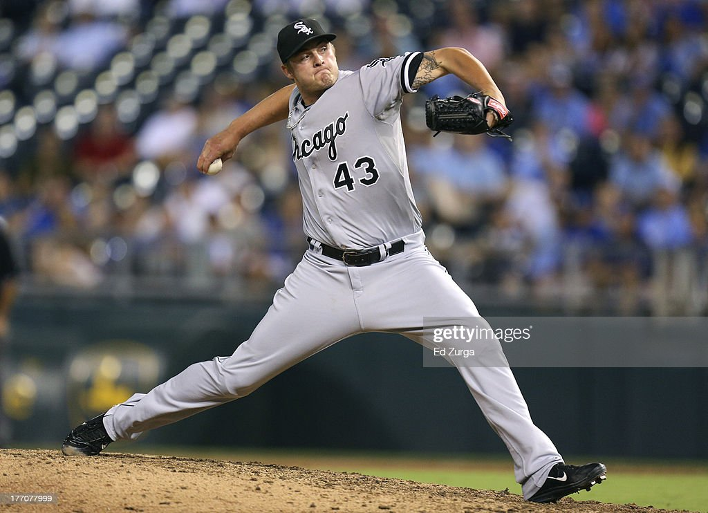 Addison Reed #43 of the Chicago White Sox throws in the ninth inning against the Kansas City Royals at Kauffman Stadium August 20, 2013 in Kansas City, Missouri.