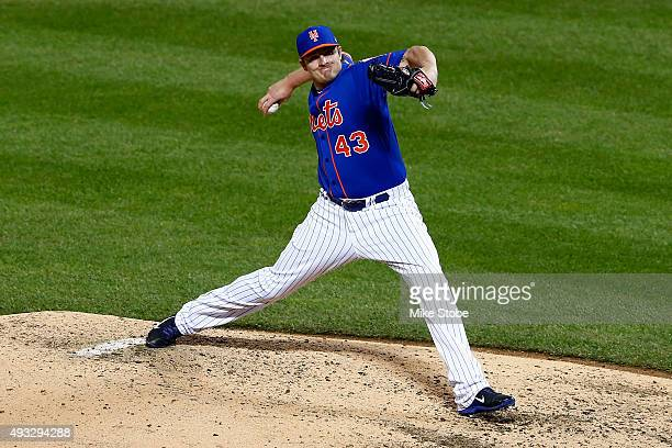 Addison Reed of the New York Mets throws a pitch against the Chicago Cubs during game two of the 2015 MLB National League Championship Series at Citi...