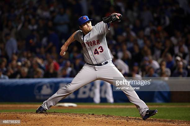 Addison Reed of the New York Mets throws a pitch against the Chicago Cubs during game four of the 2015 MLB National League Championship Series at...
