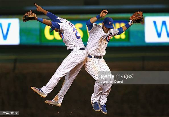 Addison Russell and Ben Zobrist of the Chicago Cubs celebrate a win over the Milwaukee Brewers at Wrigley Field on April 26 2016 in Chicago Illinois...
