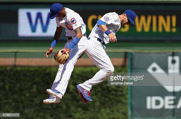 Addison Russell and Ben Zobrist of the Chicago Cubs celebrate a win over the Texas Rangers at Wrigley Field on July 16 2016 in Chicago Illinois The...