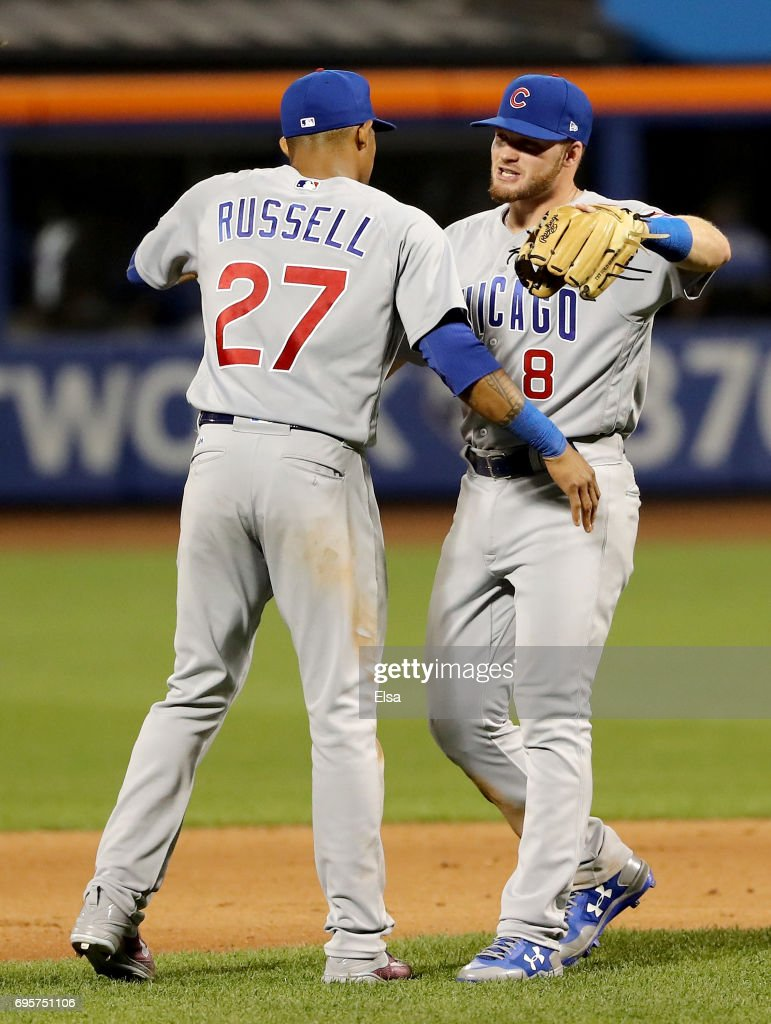 Addison Russell #27 and Ian Happ #8 of the Chicago Cubs celebrate the win over the New York Mets on June 13, 2017 at Citi Field in the Flushing neighborhood of the Queens borough of New York City.