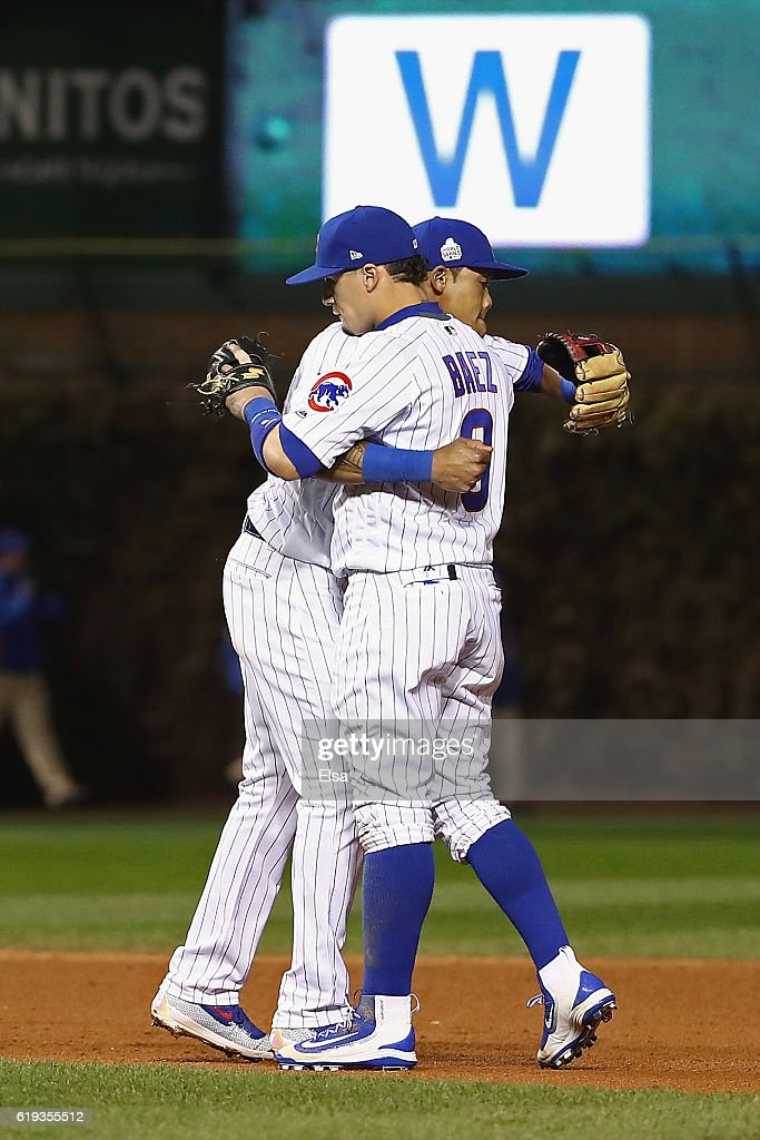 Addison Russell #27 (L) and Javier Baez #9 of the Chicago Cubs celebrate after beating the Cleveland Indians 3-2 in Game Five of the 2016 World Series at Wrigley Field on October 30, 2016 in Chicago, Illinois.
