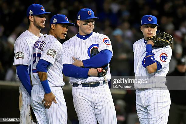 Addison Russell Kris Bryant Anthony Rizzo and Javier Baez of the Chicago Cubs look on during a pitching change during Game 5 of the 2016 World Series...
