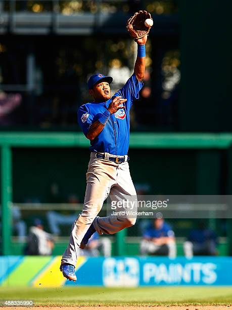 Addison Russell of the Chicago Cubs catches a line drive in the infield against the Pittsburgh Pirates during game one of the doubleheader at PNC...