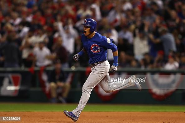 Addison Russell of the Chicago Cubs celebrates as he runs the bases after hitting a grand slam home run during the third inning against the Cleveland...