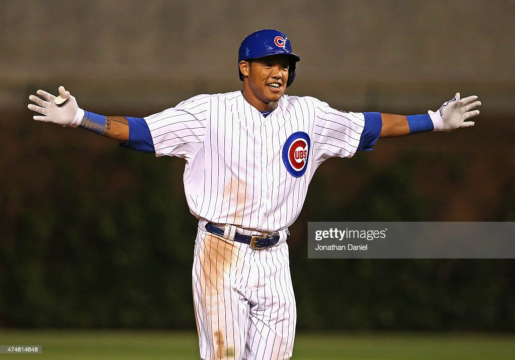 Addison Russell #22 of the Chicago Cubs celebrates getting the game-winning hit, a double off of the center field wall, in the bttom of the 9th inning against the Washington Nationals at Wrigley Field on May 26, 2015 in Chicago, Illinois. The Cubs defeated the Nationals 3-2.