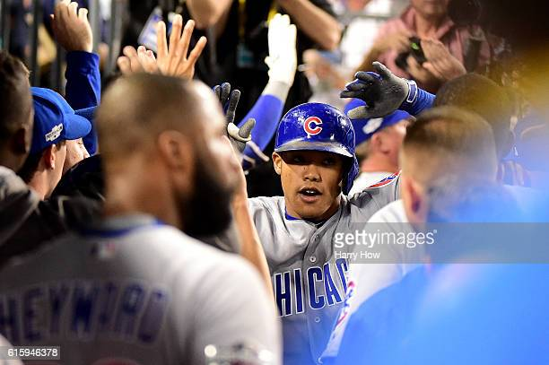 Addison Russell of the Chicago Cubs celebrates in the dugout after hitting a tworun home run in the sixth inning against the Los Angeles Dodgers in...